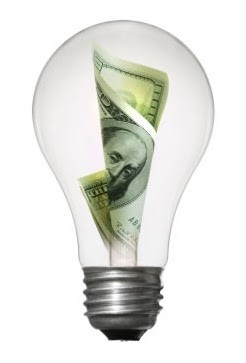 light bulb with 100 dollar bill in middle