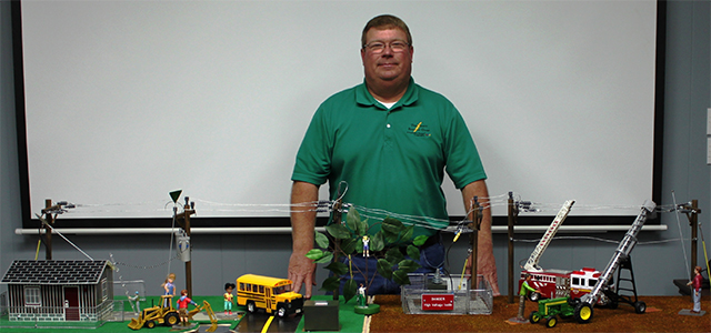 Rusty Smith Poses with a Power Safety Demonstration Set