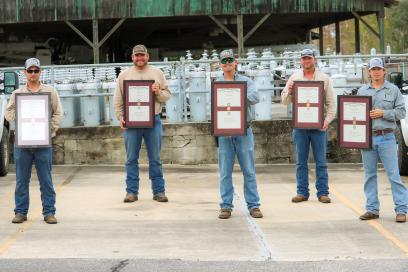 5 Male TCEC employees outside holding framed certificates