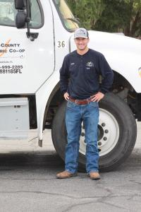 Hunter Handley - new employee - young man standing outside by utility truck